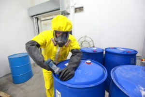 Worker in a chemical plant, who is at a high risk of suffering injury while on the job.