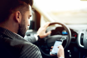 Driver using mobile phone while driving